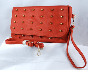 Front view of spike suede purse showing strap & wristlet