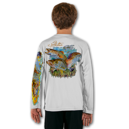 White   Stay cool with Jason Mathias's popular line of T-shirts for boys and girls! Catch your kids a Jason Mathias youth tee to match the one that you have, or help inspire their love for their favorite fish species like this awesome scene featuring the ultimate inshore slam with a Snook, Trout and Redfish. This fine art design is sublimated using superior technology that definitely makes for a top favorite among all young anglers and outdoor enthusiasts worldwide!  Say goodbye to sunburns and hello to the supreme comfort of the Jason Mathias youth Solar Performance Long Sleeve shirt! This awesome shirt offers superior sun protection and performance qualities. It is so comfortable that you will feel like you're not even wearing a shirt! Our shirts don't snag or catch, which makes it a must when doing what you do best! Featuring up to UPF +50 solar protection, the Solar Performance Long Sleeve is lightweight, comfortable, and sure to keep the sun's rays from penetrating through to your skin. This fabric is powered by PURE-tech™ moisture wicking technology which will keep you cooler in the summer and warmer in the winter.  Fabric: 4.1oz. / 100% Performance w/ UPF Protection  Made in USA