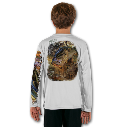 White  Stay cool with Jason Mathias's popular line of T-shirts for boys and girls! Catch your kids a Jason Mathias youth tee to match the one that you have, or help inspire their love for their favorite fish species like this awesome scene featuring a big Largemouth Bass jumping out of a sunset swamp after a Dragonfly. This fine art design is sublimated using superior technology that definitely makes for a top favorite among all young anglers and outdoor enthusiasts worldwide!  Say goodbye to sunburns and hello to the supreme comfort of the Jason Mathias youth Solar Performance Long Sleeve shirt! This awesome shirt offers superior sun protection and performance qualities. It is so comfortable that you will feel like you're not even wearing a shirt! Our shirts don't snag or catch, which makes it a must when doing what you do best! Featuring up to UPF +50 solar protection, the Solar Performance Long Sleeve is lightweight, comfortable, and sure to keep the sun's rays from penetrating through to your skin. This fabric is powered by PURE-tech™ moisture wicking technology which will keep you cooler in the summer and warmer in the winter.  Fabric: 4.1oz. / 100% Performance w/ UPF Protection  Made in USA
