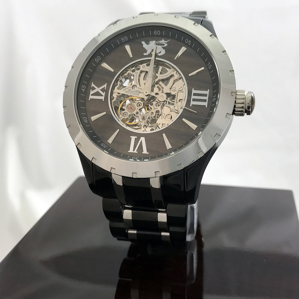 Automatic XO Skeleton Movement, Silverand Black Ionic Plating, Real Wood Face, Cutout Center and Clear Back provide full clear view of the inner workings.