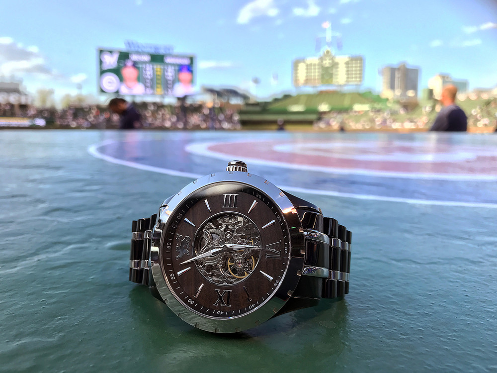 Wear the History.  Share the History.  The 1753 Watch by Banneker shown sitting on top of the legendary dugout at Wrigley Field.  Home of the 2016 World Champion Chicago Cubs.  #FlyTheW