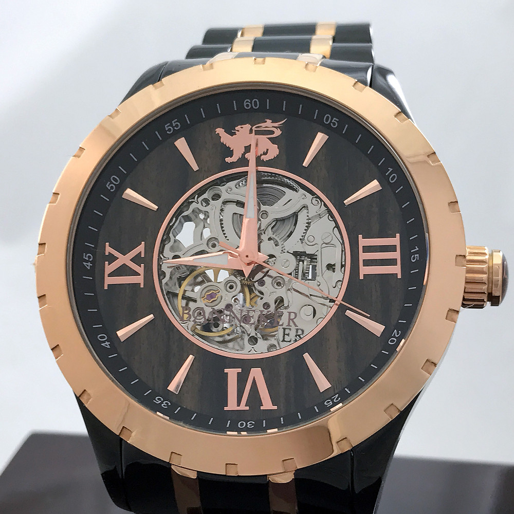 Automatic XO Skeleton Movement, Rose Gold and Black Ionic Plating, Real Wood Face, Cutout Center and Clear Back provide full clear view of the inner workings.