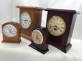 The smaller Banneker Clocks are the 3500 BC Desk Clock made from a solid block of American Cherry Wood.  The Larger clocks are the Hardaway shown in both Red Heat and Gold Medal color choices.  The Hardaway is available as a silent clock or with a chiming feature that recreates the classic chiming sounds of Grandfather Clocks.