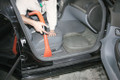 Cleaning car with orange bear claw tool.