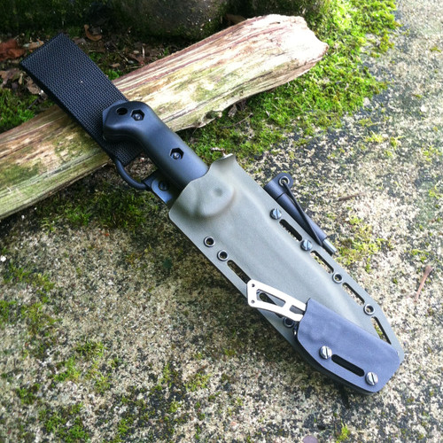 Piggyback Grizzly Elite Custom KYDEX sheath for Becker BK7 and BK13 angled in Olive Drab and Black with milled slots, firesteel and D-ring swivel belt loop.  Suitable for Becker, Esee, Cold Steel, Ka-Bar, Mora, Ontario, Schrade, and SOG knives.