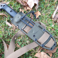 A Straight Piggyback custom KYDEX sheath with firesteel, milled slots, and leg strap in Olive Drab.  For Becker, Cold Steel, Esee, Ka-Bar, Mora, Ontario, Schrade, and SOG knives.