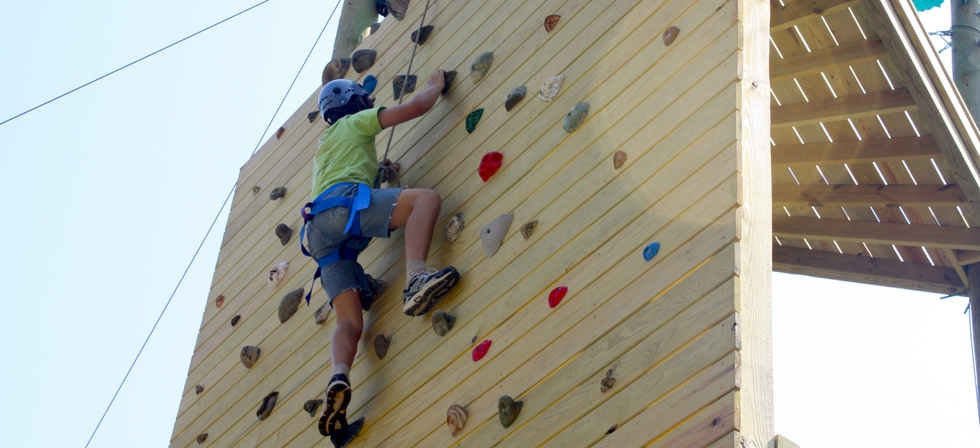 Camper on climbing wall at Pine Ridge Day Camp in North AL