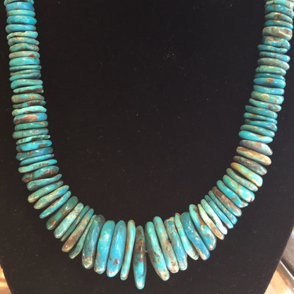 These natural Sleeping Beauty, Arizona turquoise beads are unusual in shape and size.   The mine is now closed, so this material is becoming very rare.  These beads are a bright, vivid turquoise color with a slight teal hue.  The largest bead measures 30 x 23 mm.