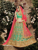 Incredibly Graceful Aqua Blue Colored Net Lehenga