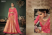 Exquisitely Radiant Light Pink Colored Banarasi Silk Lehnega