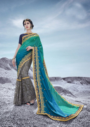 Alluring & Trendy Sky Green & Grey Colored Moss Georgette Saree