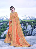 Delightfully Alluring Light Orange Colored Pure Georgette Saree