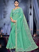 Delightfully Charming Green Colored Georgette Saree