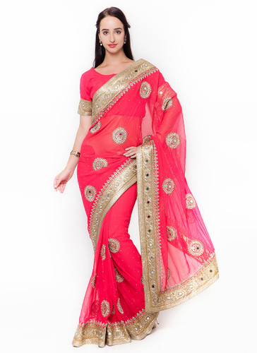 Graceful & Gorgeous Peach Colored Georgette Saree