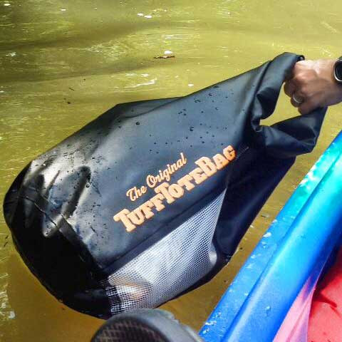 Class 3 Tuff Tote being demonstrated as waterproof on the river.