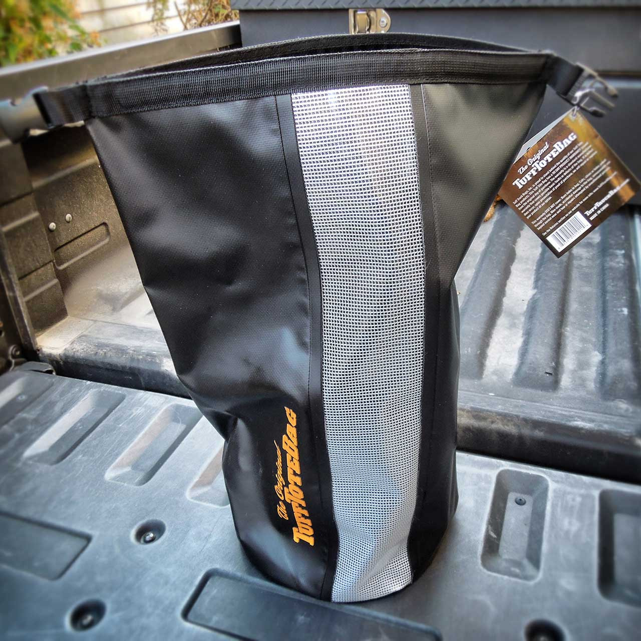 Front view of the rolled open top of the black waterproof Tuff Tote bag.