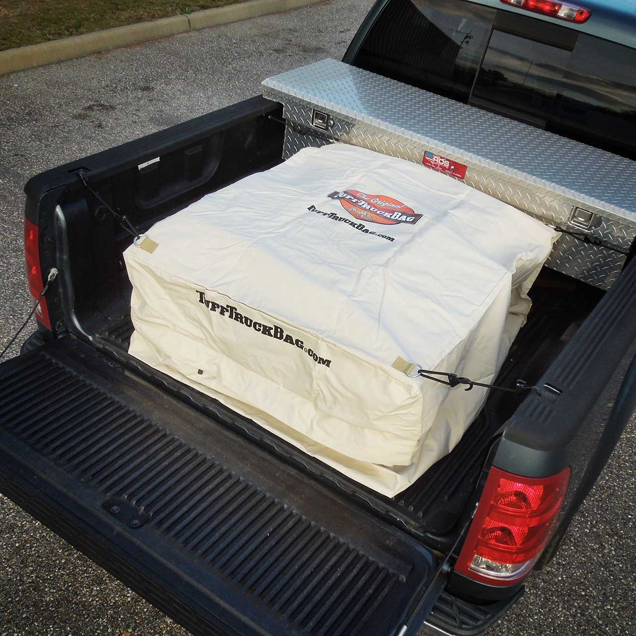 Top view of a waterproof Khaki Tuff Truck Bag in a pickup truck bed with the tailgate open