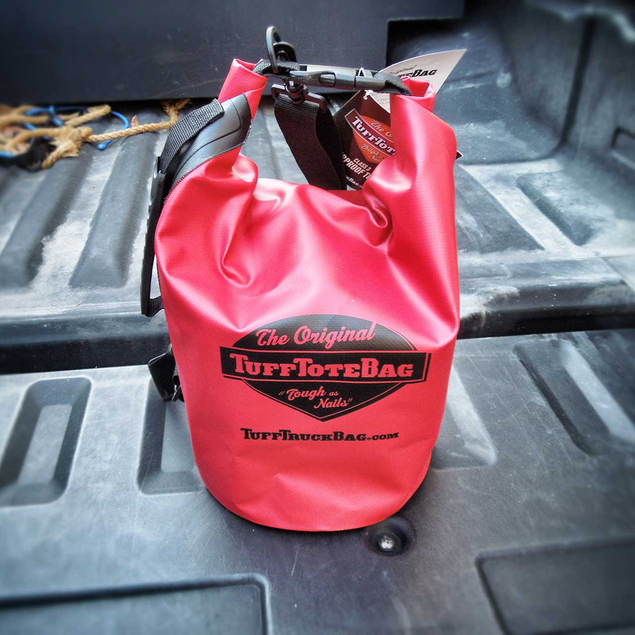 Front view of the red waterproof class 3 dry bag with roll down handle.