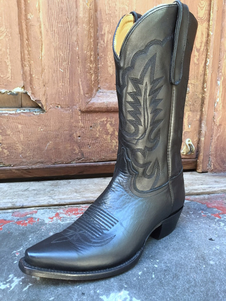 black cowboy boot in the bright light