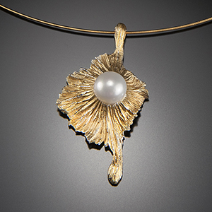 Alexandra Vali's 20k gold de'salanum pendant with a white Akoya pearl