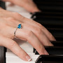 Infinite Hope Ring - Blue Topaz on Model, Art Jewelry by Aleksandra Vali