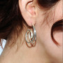 Spiral Earrrings on model, Contemporary Jewelry by Cheryl Eve Acosta