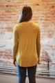 Dark mustard long sleeve top back view.