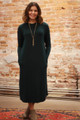 Simply Basics Dark Green Long Sleeve Midi Dress with Pockets front view.