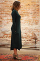 Simply Basics Dark Green Long Sleeve Midi Dress with Pockets side view.