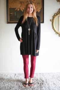 Simply Basics Black Long Sleeve Ruffle Tunic full body front view.