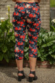 Vibrant Roses Floral Printed Butter Soft Cropped Leggings back view.