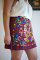 Stitched to Perfection Wine Floral Embroidered Mini Skirt side view.
