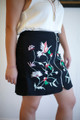 Embroidered Style Black Zipper Front Mini Skirt side view.