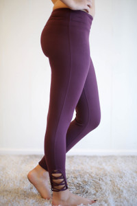 Activated Athletics Magenta Leggings with Crossed Detail side view.