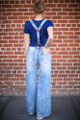 All for Acid Wash Bell Bottom Distressed Jeans with Suspenders back view.