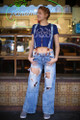 All for Acid Wash Bell Bottom Distressed Jeans with Suspenders front view.