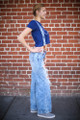 All for Acid Wash Bell Bottom Distressed Jeans with Suspenders side view.