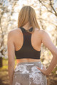 Activated Athletics Black Seamless Twist Front Sports Bra back view.