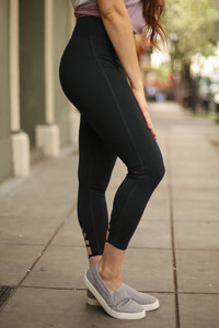 Activated Athletics Black Capri Leggings with Cross Calf Detail side view.