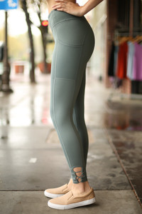 Activated Athletics Teal Blue Mesh Pocket Leggings side view.