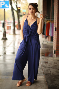 Ride the Waves Navy Draped Jumpsuit with Pockets front view.