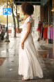 All Into Ivory Lace Maxi Dress with Slit side view.