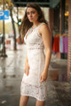 Dressed to the Nines Ivory Lace Sleeveless Bodycon Dress side view.