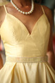 Midnight Glamour Yellow Satin Gown with Rhinestone Band bodice view.