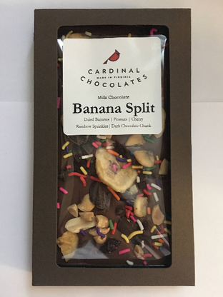Milk Chocolate topped with dried cherries, banana chips, dark chocolate chunks, rainbow sprinkles, and peanuts.