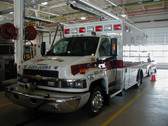 Ambulance with decals and striping done by Dornbos Sign Inc.
