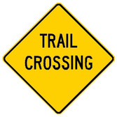 "diamond shape, yellow sign, black words ""trail crossing"""