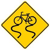 diamond shape, black and yellow. image of bike slipping