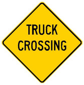 "Yellow sign, says ""Truck Crossing"" in black letters"
