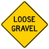 "Yellow sign. ""Loose Gravel"" in black letters"
